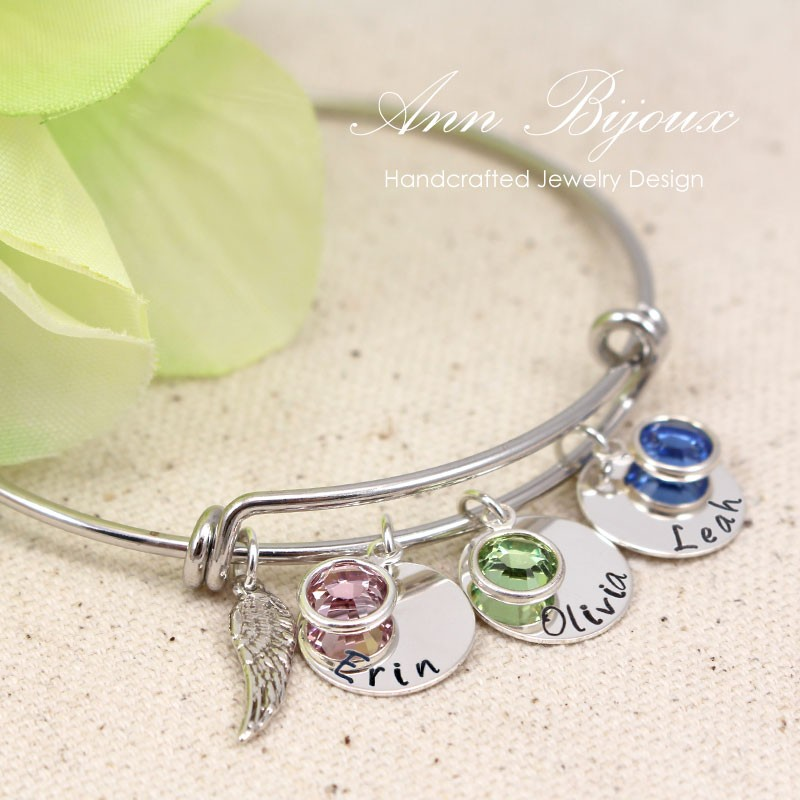 3b8b735d5ed66 Hand Stamped Family Name with Angel Wing Bangle Bracelet
